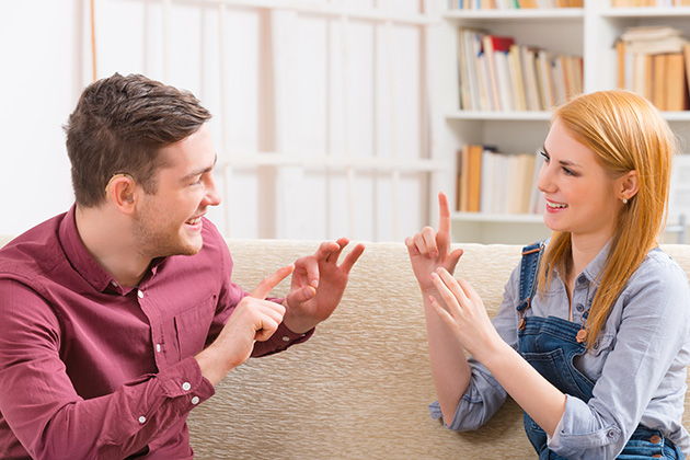 Man and woman using sign language in their conversation